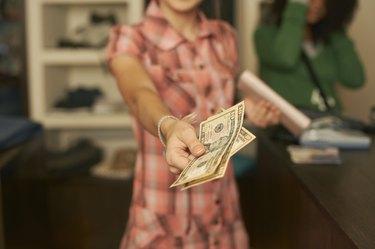 Teenage girl offering money