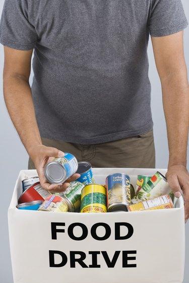 Man holding food drive box