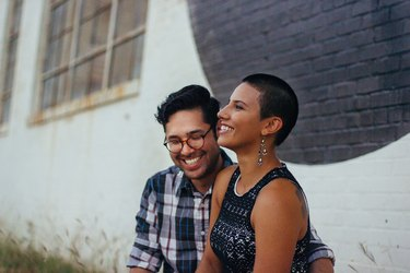 Cute Latinx couple smiling together