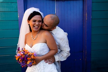 A bride and groom enjoying a candid moment on their wedding day