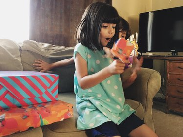 Girl excited to open birthday present