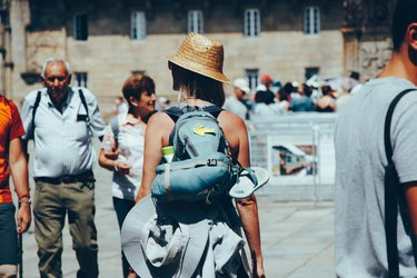 Young white woman in hiking gear on pilgrimage