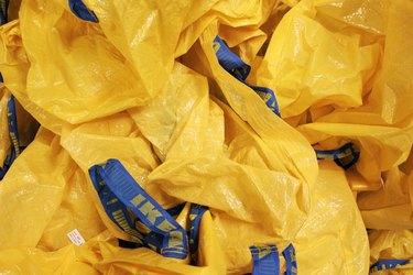 Pile of yellow IKEA reusable plastic shopping bags
