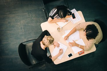 Overhead shot of three women working at a desk together