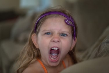 Angry child yelling at the camera