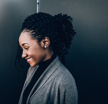 Young Black woman in business casual smiling