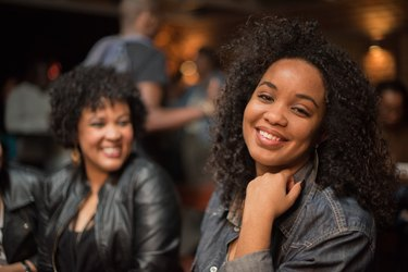Smiling African women in hip jackets