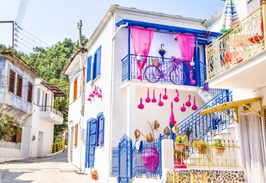 White house with bright pink and blue accents