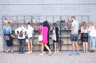 Shoppers examining books for sale on a city street