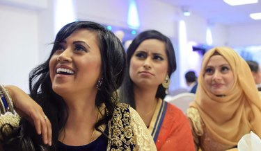 Three women with a variety of expressions