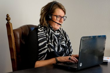 Woman at laptop wearing headset