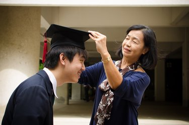 Mom adjusts grown son's graduation cap