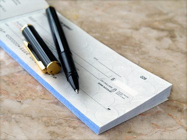 How to Tell if a Check is Fake                             Cheque with Pen