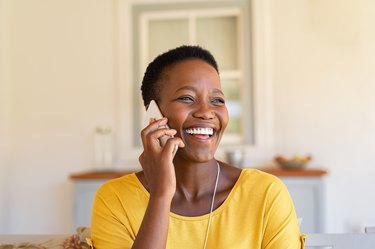 Woman laughing while talking on phone