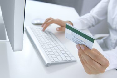 A woman shopping online using her MasterCard
