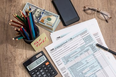 What Is the Purpose of Tax Returns?               tax time. tax form with money. pen