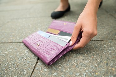 Woman Picking Up Fallen Wallet