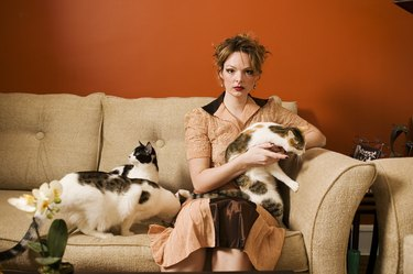 Portrait of young woman with cats