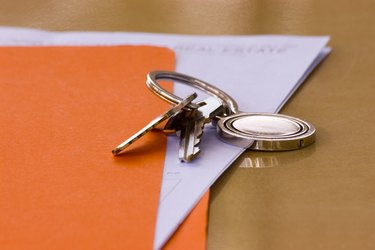 How to Do a Quit Claim Deed in Maryland Real Estate Contract and Keys with Orange Folder