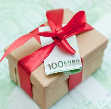 How to Buy U.K. Premium Bonds                  gift box with  euro banknote