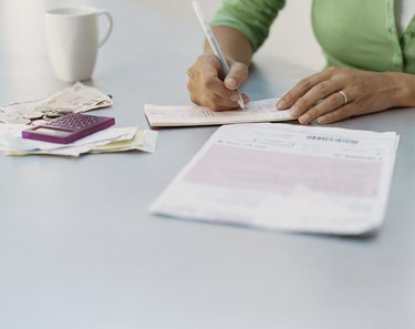 Woman Writing a Cheque