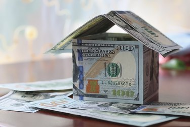 How Long Can I Go Without Paying Property Taxes Before I Will Be in Foreclosure?Real Estate dollar house background