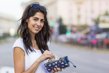 Portrait of beautiful woman with wallet in the hands