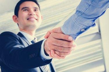 What Is a Non-Mandatory or Reorganization Tender Stock Offer?Businessmen making handshake