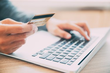 Man making online purchase with credit card