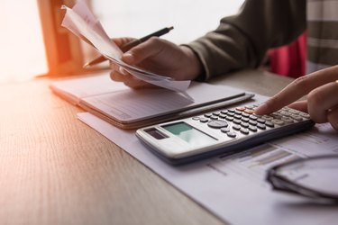 people calculate about cost at home ,Finance managers task,Concept business and finance