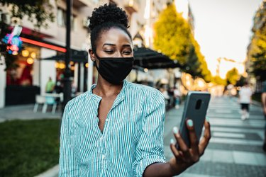 Woman with a mask taking a selfie