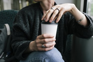A Woman Holding A Takeout Coffee