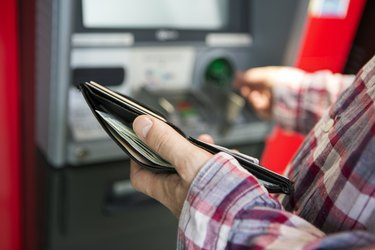 Man withdrawing money from ATM
