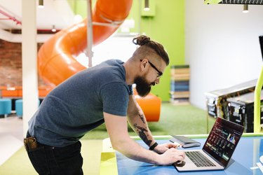 Computer programmer working in creative office
