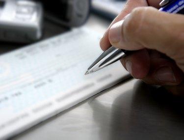 Signing a bank check, business metaphor