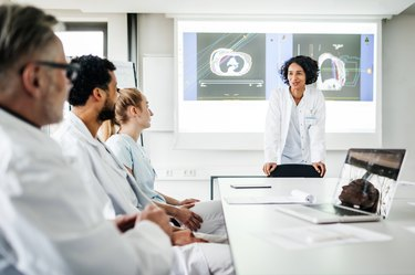 Doctors Discussing Research Data Togeher