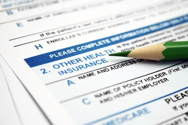 What Is a Crossover Claim?                             Health insurance form with lead pencil resting on it