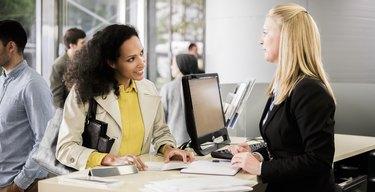 Female bank teller advising female customer