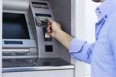 Man using a ATM