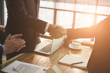 realtor & client handshaking. real estate agent shaking hands with customer. sale & purchase property with signing contract document & approved mortgage loan