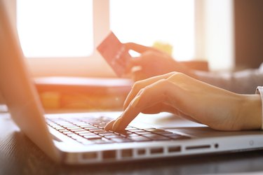 How to Change the Closing Date on an American Express Credit CardWoman Shopping Online Using Laptop With Credit Card