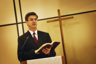 Pastor preaching from pulpit