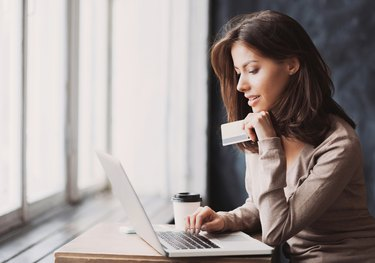 Woman is shopping online with laptop