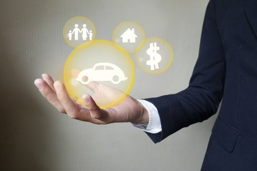 Difference Between Liability and Collision InsuranceBusinessman holding protect car , insurance concept