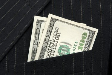 The Best Ways to Invest $200                     200 dollars in pocket close up