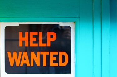 Help Wanted Sign in Old Blue Window