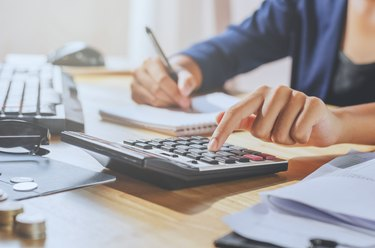 businessman using calculator on desk office business financial accounting concept