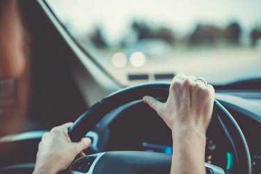 Woman driving car or SUV