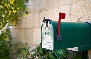 How Do I Find Someone Who Has Moved?US post mail letter box with red flag