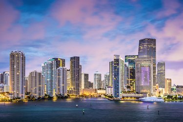 Ocean skyline view of Miami with pink clouds